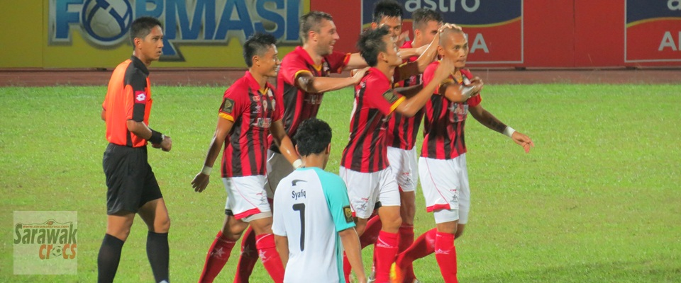 Ronny Harun congratulated by his buddies after his lovely goal.